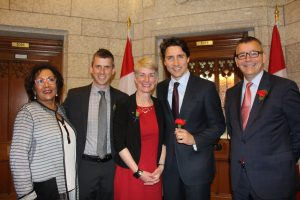 Prime Minister Justin Trudeau and members of the MS Society of Canada and the Parliament