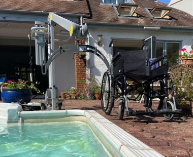 swimming pool \ Multiple Sclerosis News Today \ Columnist John Connor's wheelchair sits next to his swimming pool at his London home, in front of a mechanical lift he uses to transport himself into the pool