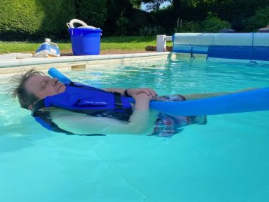 swimming pool \ Multiple Sclerosis News Today \ Columnist John Connor floats on his back in a swimming pool at his home. With a buoyancy jacket, John's eyes are closed in deep relaxation