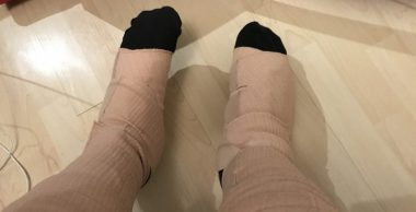 medical equipment \ MS News Today \ Columnist John Connor's legs are wrapped in an older version of compression wraps to combat his lymphedema