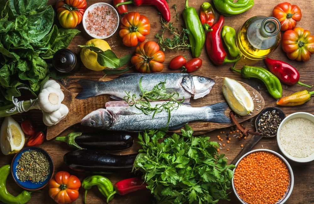 diet and fatigue   Multiple Sclerosis News Today   Research   Overhead shot of colorful fruits, vegetables, herbs, spices, grains, fish