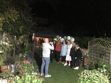 family gathering | MS News Today | A backyard photo at night shows a family party with John Connor's relatives, complete with balloons and an outdoor bar